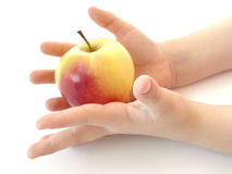 Hands with apple. Child hands with an apple Stock Image