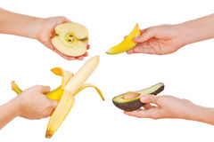 Hands with apple, avocado, banana and mango Royalty Free Stock Images