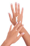 Hands applying cream Stock Images