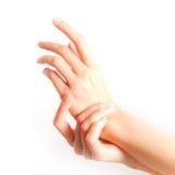 Hands applying cream. Beautiful woman hands applying cream Royalty Free Stock Photos