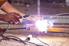 Hands and arc welder. Close up on the hands using a blowtorch Stock Images
