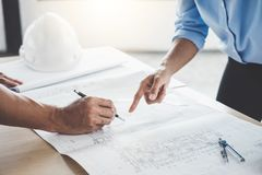 Hands of architect or engineer working on blueprint meeting for. Project working with partner on model building and engineering tools in working site Stock Photo