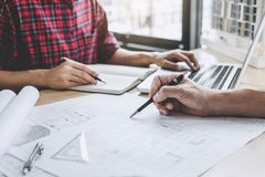 Hands of architect or engineer working on blueprint meeting for royalty free stock image