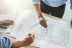Hands of architect or engineer working on blueprint meeting for. Project working with partner on model building and engineering tools in working site Stock Photos