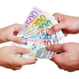 Hands arguing over Euro money bills Stock Photos