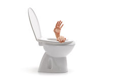 Hands arising from a toilet bowl Royalty Free Stock Photos