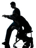 Hands arms massage therapy with chair silhouette Royalty Free Stock Photos