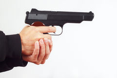 Hands with army handgun on white background Royalty Free Stock Photography
