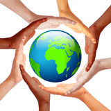 Hands around earth. International friendship concept Stock Photography