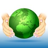 Hands around earth Stock Images