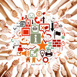 Hands around icons holding thumbs Stock Image