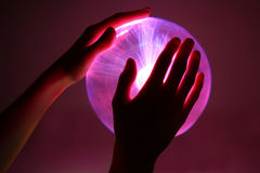 Hands Around Plasma Ball Stock Photos