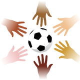 Hands around a soccer ball stock photo