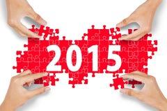 Hands arrange number 2015 Royalty Free Stock Photo