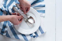 Hands arranging cutlery Stock Photos