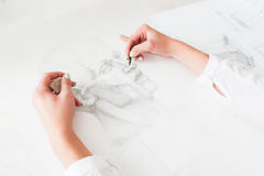 Hands of artist drawing portrait with pencil Stock Images