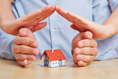 Hands as a roof over a house Royalty Free Stock Image