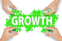 Hands assemble growth puzzle Royalty Free Stock Photo
