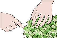 Hands assembling green puzzle Royalty Free Stock Images