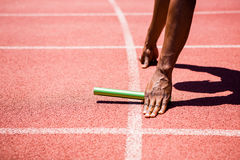 Hands of athlete holding baton Royalty Free Stock Photos