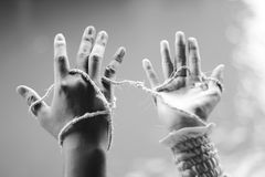 Hands Attached. Man and woman engaging symbol with hand attached with rustic rope Royalty Free Stock Photography