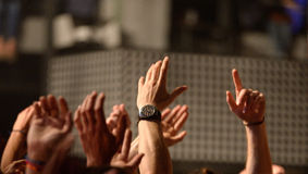 Hands from the audience in a concert at Razzmatazz stage Stock Image