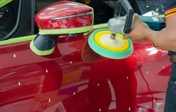 Auto Detailing Car. Hands with Auto polisher. Car wax Royalty Free Stock Photography