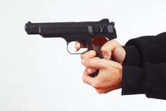 Hands with automatic gun on white background Stock Photos
