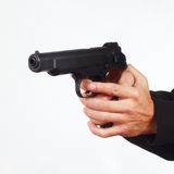 Hands with automatic handgun on white background Stock Images