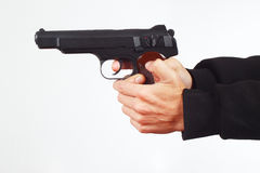Hands with automatic pistol on white background Stock Photography
