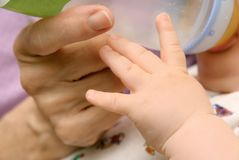 Hands of baby and grandma Royalty Free Stock Photos