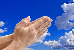 Hands on background sky. Stock Photography