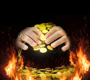 Hands on a bag of gold coins Royalty Free Stock Photos