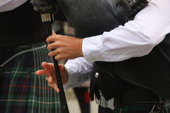 Hands of a bagpiper. Stock Images