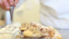 Hands baker decorate pastries stock video footage