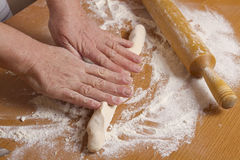 Hands of the baker Stock Photo