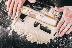 Hands baking dough. With rolling pin Royalty Free Stock Image