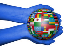 Hands with ball with flags , map of the world drawn Royalty Free Stock Photos