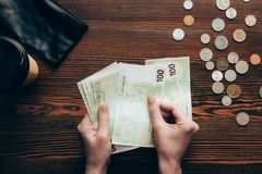 Hands with banknotes and coins Royalty Free Stock Photos
