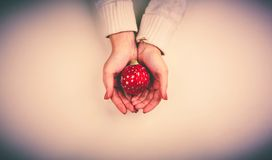 Hands with bauble Royalty Free Stock Image