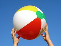 Hands with beach ball Stock Photo