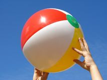 Hands with beach ball Stock Photography