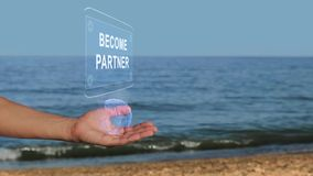 Hands on beach hold hologram text Become partner