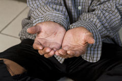 The hands of a beggar. In an old shirt Stock Images