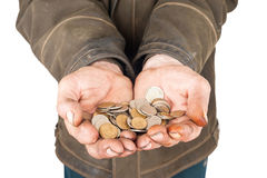 Hands of a beggar with coins Stock Photo