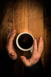 Hands of a beggar holding a cup Stock Photo