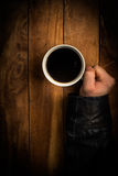 Hands of a beggar holding a cup Royalty Free Stock Photos