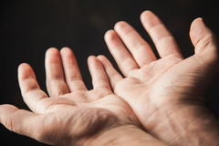 Hands begging. On a brown background Stock Photography