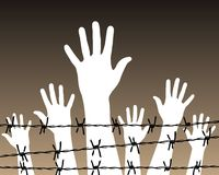 Hands behind a barbed wire prison Royalty Free Stock Photography
