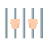 Hands behind bars Stock Photo